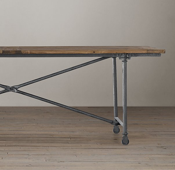 Cast metal with elmwood create a magnificent dining room table