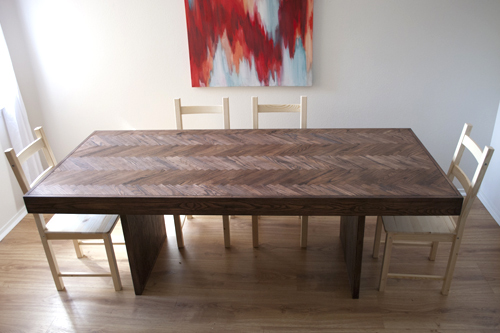 A beautiful dining room table created from an old table and various other materials.