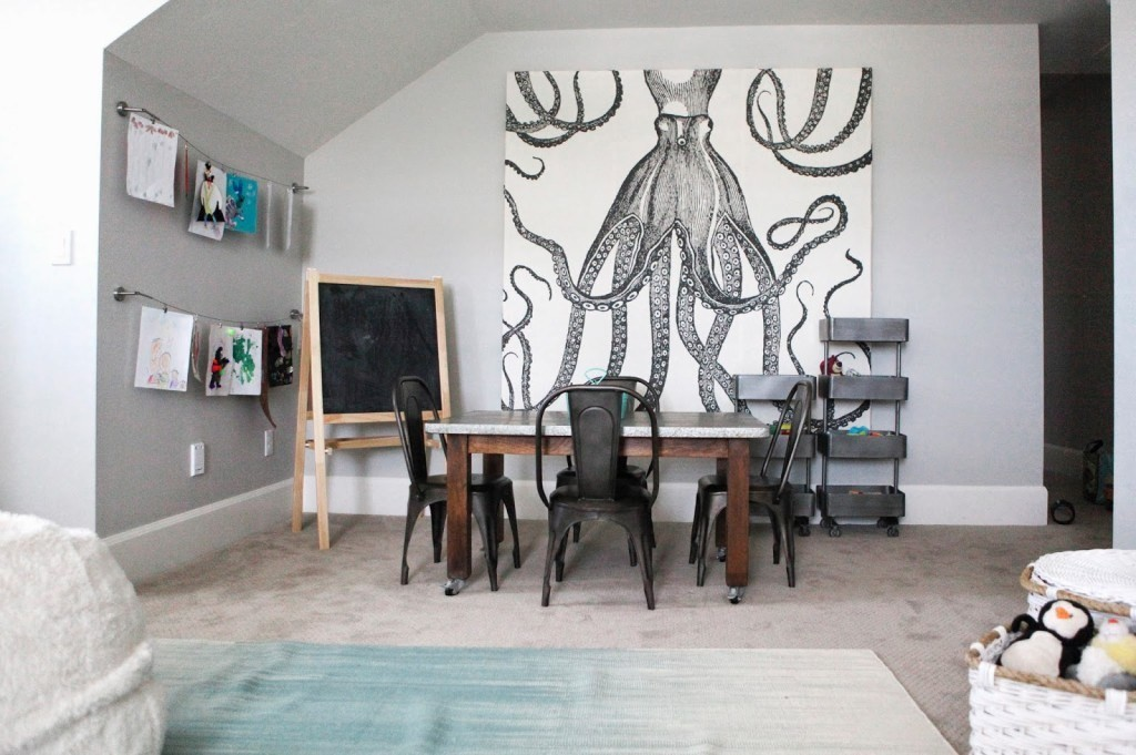 A DIY canvas portrait created with an octopus shower curtain and wood hung up in a living room.